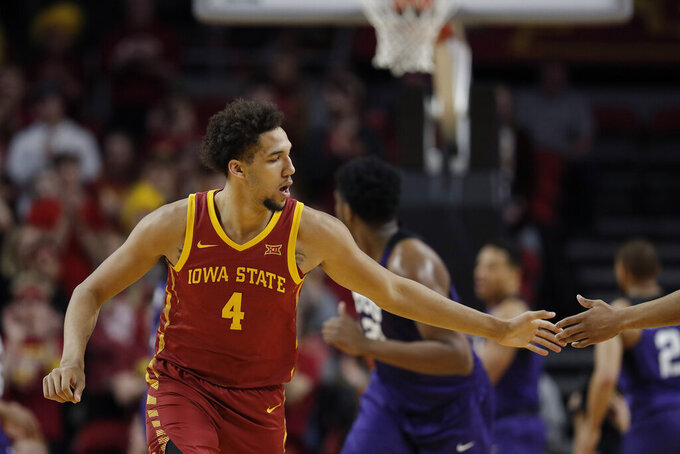 Iowa State forward George Conditt celebrates a basket over TCU during the second half of an NCAA college basketball game, Tuesday, Feb. 25, 2020, in Ames, Iowa. Iowa State won 65-59. (AP Photo/Matthew Putney)