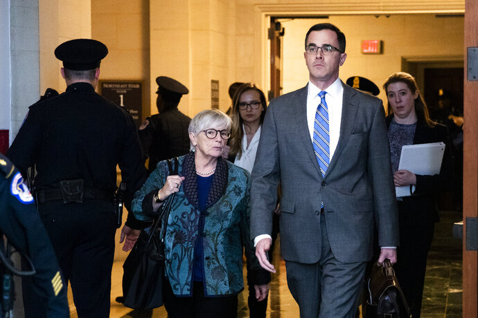 Tim Morrison, a former official at the National Security Council, arrives to testify before the House Intelligence Committee on Capitol Hill in Washington, Tuesday, Nov. 19, 2019, during a public impeachment hearing of President Donald Trump's efforts to tie U.S. aid for Ukraine to investigations of his political opponents. (AP Photo/Manuel Balce Ceneta)