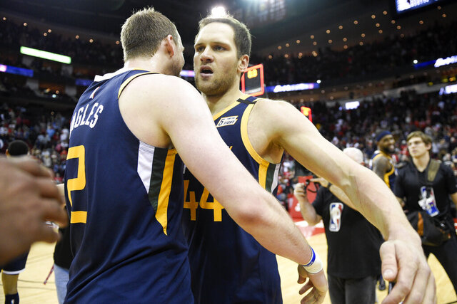 Utah Jazz forward Bojan Bogdanovic, right, celebrates shooting the game-winning three point basket with Joe Ingles during the second half of an NBA basketball game against the Houston Rockets, Sunday, Feb. 9, 2020, in Houston. (AP Photo/Eric Christian Smith)