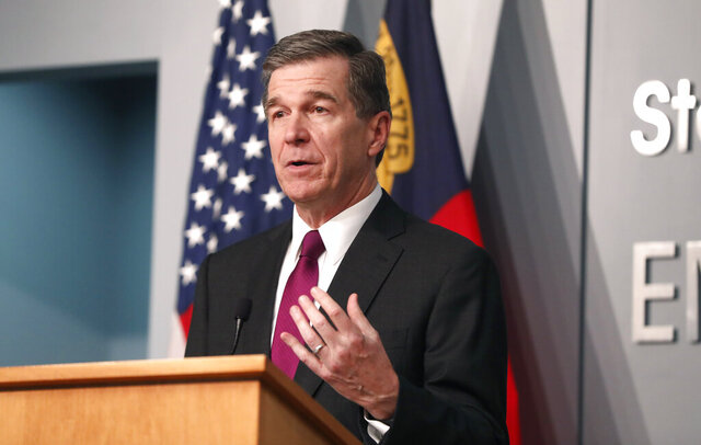 Gov. Roy Cooper answers a question during a briefing at the Emergency Operations Center in Raleigh, N.C., Wednesday, July 1, 2020.  (Ethan Hyman/The News & Observer via AP)