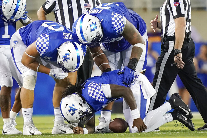 Kentucky QB Wilson out for season with knee injury