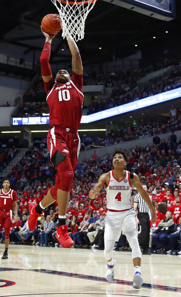 Arkansas forward Daniel Gafford (10) attempts a dunk as Mississippi guard Breein Tyree (4) watches during the second half of the NCAA college basketball game in Oxford, Miss., Saturday, Jan. 19, 2019. Mississippi won 84-67. (AP Photo/Rogelio V. Solis)