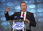 FILE - In this July 17, 2019, file photo, Louisville head coach Scott Satterfield speaks during the Atlantic Coast Conference NCAA college football media day in Charlotte, N.C. Another season begins for the Louisville Cardinals with another new defensive coordinator and system to learn. Satterfield expects growing pains with the transition, but he's encouraged by Louisville's effort so far.(AP Photo/Chuck Burton, File)