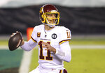 FILE - Washington Football Team quarterback Alex Smith (11) is shown in action against the Philadelphia Eagles during an NFL football game in Philadelphia, in this Sunday, Jan. 3, 2021, file photo. Smith announced his retirement Monday, April 19, 2021, on Instagram, saying he still has plenty of snaps left him just shy of his 37th birthday but is calling it quits to enjoy time with his family. (AP Photo/Rich Schultz, FIle)