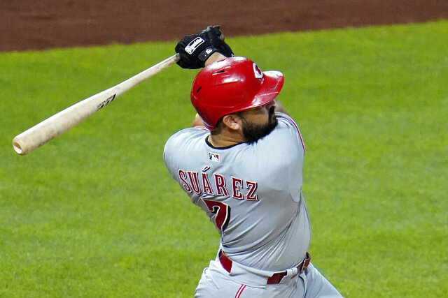 Cincinnati Reds' Eugenio Suarez follows through on a solo home run, his third homer of the night, off Pittsburgh Pirates relief pitcher Derek Holland during the eighth inning of a baseball game in Pittsburgh, Saturday, Sept. 5, 2020. The Reds won 6-2. (AP Photo/Gene J. Puskar)