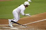 Miami Marlins' Harold Ramirez watches his RBI-single to score two runs during the third inning of a baseball game against the Philadelphia Phillies, Friday, Aug. 23, 2019, in Miami. (AP Photo/Lynne Sladky)