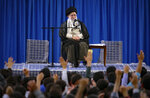 FILE - In this file photo released May 22, 2019, by an official website of the office of the Iranian supreme leader, Supreme Leader Ayatollah Ali Khamenei attends a meeting with a group of students as they chant slogans, in Tehran, Iran. On May 14, 2019, Khamenei says