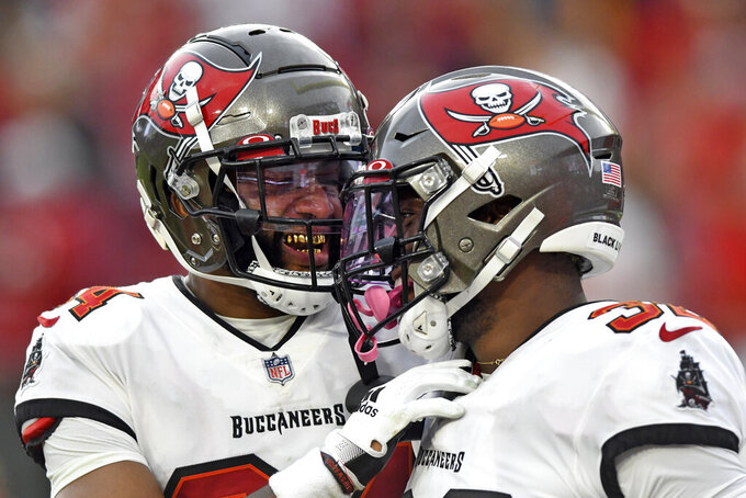Tampa Bay Buccaneers safety Mike Edwards, right, celebrates with cornerback Carlton Davis III after Edwards returned an interception against the Atlanta Falcons for a score during the second half of an NFL football game Sunday, Sept. 19, 2021, in Tampa, Fla. (AP Photo/Jason Behnken)