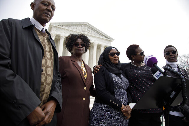 Family and victims of the 1998 U.S. embassy bombings in Tanaznia and Kenya, from left, Tibruss Minja, Doreen Oport, Rukia Ali, Joanne Oport, and Clara Owino, attend a news conference following Supreme Court arguments on punitive damages against Sudan for its role in the attack, Monday, Feb. 24, 2020, outside of the Supreme Court in Washington. (AP Photo/Jacquelyn Martin)