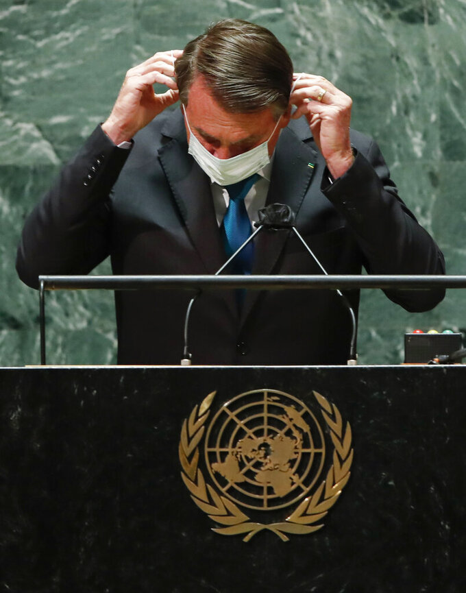 Brazil's President Jair Bolsonaro puts back on a protective face mask after addressing the 76th Session of the U.N. General Assembly, Tuesday, Sept. 21, 2021, at United Nations headquarters in New York. (Eduardo Munoz/Pool Photo via AP)