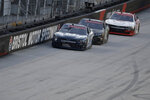 Ryan Sieg (39) drives followed by Riley Herbst (18) and Myatt Snider, right, during NASCAR Xfinity Series auto race at Bristol Motor Speedway Monday, June 1, 2020, in Bristol, Tenn. (AP Photo/Mark Humphrey)