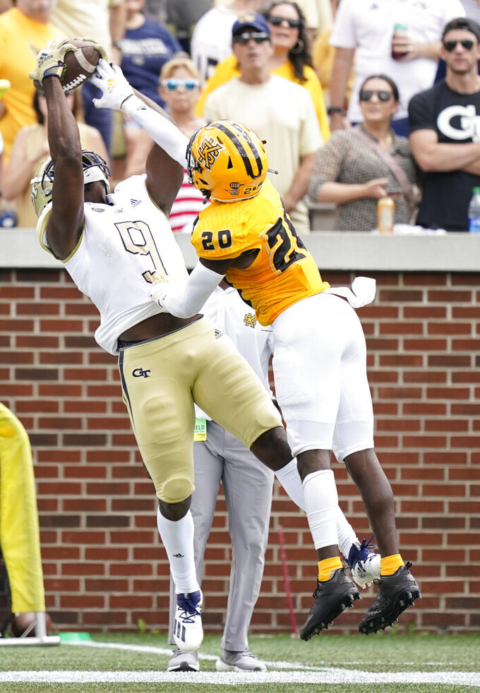 Georgia Tech wide receiver Avery Boyd (9) catches the pass against Kennesaw State defensive back Erwin Byrd (20) during the first half of an NCAA college football game, Saturday, Sept. 11, 2021, in Atlanta. (AP Photo/Brynn Anderson)