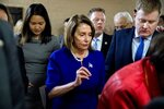 House Speaker Nancy Pelosi of Calif. speaks to an aide as she leaves a House Democratic meeting in the U.S. Capitol Building on Capitol Hill in Washington, Monday, March 25, 2019. (AP Photo/Andrew Harnik)