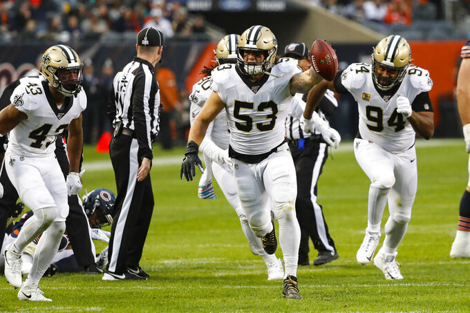 New Orleans Saints outside linebacker A.J. Klein (53) celebrates a fumble recovery against the Chicago Bears during the second half of an NFL football game in Chicago, Sunday, Oct. 20, 2019. (AP Photo/Charles Rex Arbogast)