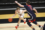Oregon State's Zach Reichle (11) tries to get past Arizona's Azuolas Tubelis (10) during the first half of an NCAA college basketball game in Corvallis, Ore., Thursday, Jan. 14, 2021. (AP Photo/Amanda Loman)