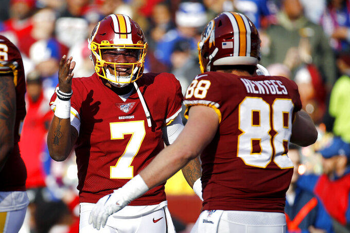 Washington Redskins quarterback Dwayne Haskins (7) and tight end Hale Hentges (88) celebrate after they connected for a touchdown pass and catch against the Washington Redskins during the first half of an NFL football game, Sunday, Dec. 22, 2019, in Landover, Md. (AP Photo/Patrick Semansky)