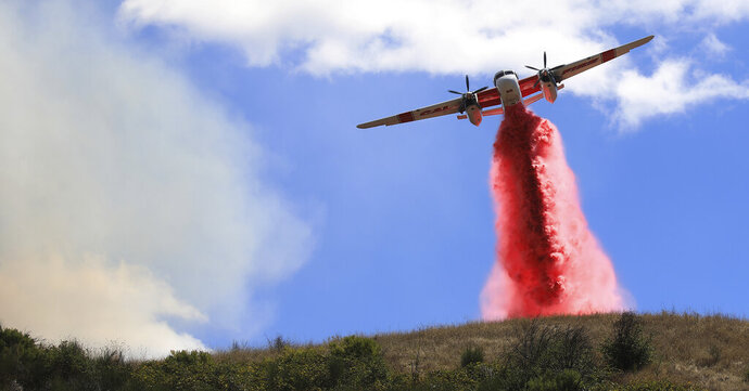 Cal Fire air tankers help stop the spread of a brush fire in Larkfield Calif, Thursday, Sept. 24, 2020. (Kent Porter/The Press Democrat via AP)