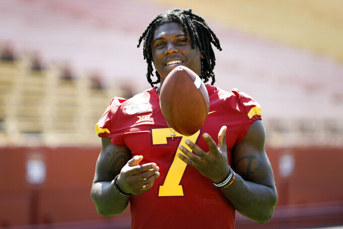 Iowa State wide receiver La'Michael Pettway tosses a football during the school's annual NCAA college football media day, Thursday, Aug. 1, 2019, in Ames, Iowa. (AP Photo/Charlie Neibergall)