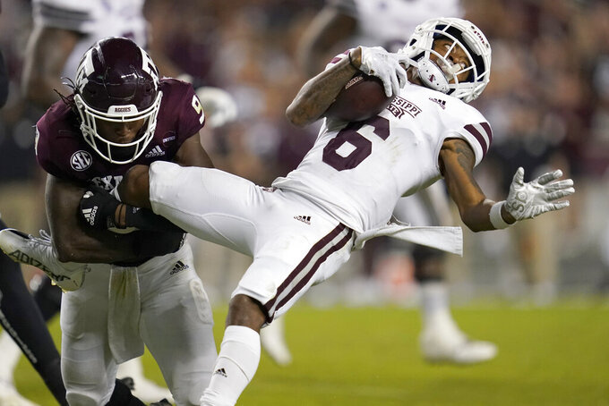 Mississippi State wide receiver Jamire Calvin (6) is tackled by Texas A&M defensive back Leon O'Neal Jr. (9) after a gain of three yards during the second half of an NCAA college football game on Saturday, Oct. 2, 2021, in College Station, Texas. (AP Photo/Sam Craft)