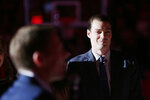 Former NBA and Gonzaga player Adam Morrison, right, watches as Gonzaga coach Mark Few speaks during a ceremony by the school to honor Morrison before an NCAA college basketball game between Gonzaga and San Diego in Spokane, Wash., Thursday, Feb. 27, 2020. (AP Photo/Young Kwak)