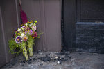 Flowers are left on the charred steps of the Adas Israel Synagogue Sunday September 15, 2019 in Duluth, Minn. A press conference was held  on Sunday morning to discuss the findings of the investigation of the Adas Israel Synagogue fire that occurred early last week. A suspected was arrested last week and will be charged with first degree arson but there is no indication at this time that it was a hate crime.  (Alex Kormann/Star Tribune via AP)