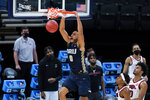 Oral Roberts forward Kevin Obanor dunks the ball during the first half of a Sweet 16 game against Arkansas in the NCAA men's college basketball tournament at Bankers Life Fieldhouse, Saturday, March 27, 2021, in Indianapolis. (AP Photo/Jeff Roberson)