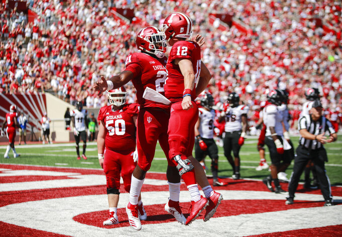 Indiana's Stevie Scott (21) celebrates after Peyton Ramsey (12) scored a touchdown against Ball State during an NCAA college football game, Saturday, Sept. 15, 2018 in Bloomington, Ind. (Jeremy Hogan/The Herald-Times via AP)