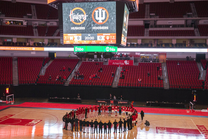 Nebraska and Indiana join at the center of the court in a moment of unity before the start of an NCAA college basketball game Sunday, Jan. 10, 2021, in Lincoln, Neb. (Kenneth Ferriera/Lincoln Journal Star via AP)