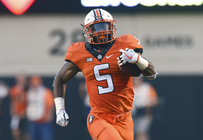 FILE - In this Aug. 30, 2018, file photo, Oklahoma State running back Justice Hill runs the ball during a college football game in Stillwater, Okla. Oklahoma State running back Justice Hill will skip his senior season and enter the 2019 NFL draft. Coach Mike Gundy announced Monday, Dec. 3, 2018, that Hill will not play against Missouri in the Liberty Bowl on Dec. 31. Hill made his announcement in a thank you letter to fans, teammates and coaches on social media.(AP Photo/Brody Schmidt, File)