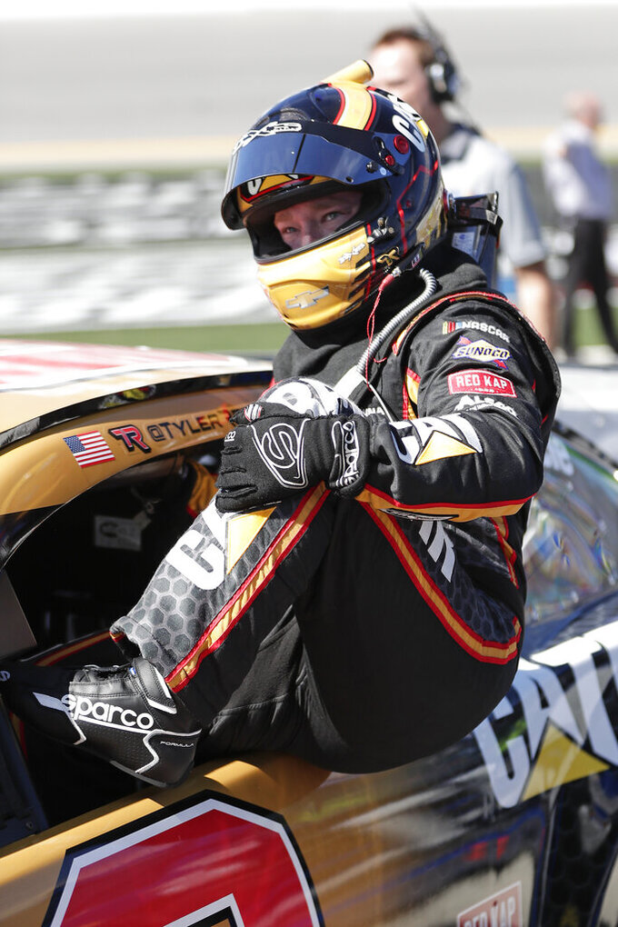 Tyler Reddick climbs out of his car after his run at NASCAR auto race qualifying at Daytona International Speedway, Sunday, Feb. 9, 2020, in Daytona Beach, Fla. (AP Photo/John Raoux)