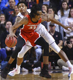 Auburn forward Chuma Okeke (5) gets a hand on the ball carried by Georgia forward Nicolas Claxton (33) during the first half of an NCAA college basketball game Saturday, Jan. 12, 2019, in Auburn, Ala. (AP Photo/Julie Bennett)