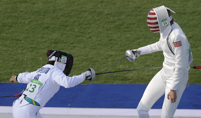 """FILE - In this Aug. 19, 2016, file photo, gold medal winner Chloe Esposito of Australia, left, competes against Isabella Isaksen of the United States in the fencing portion of the women's modern pentathlon at the Summer Olympics in Rio de Janeiro, Brazil. Esposito announced in late January that a """"wonderful, unexpected surprise"""" had occurred and that the Australian wouldn't be able to defend her modern pentathlon gold medal at the Tokyo Olympics. She was pregnant with her first child. Two months later Esposito and thousands of other Olympic athletes learned that the Tokyo Games would be put off by a year until July 2021 because of the coronavirus pandemic. While for some it meant more time to recover from injuries or extra time to prepare, Esposito realized it might give her a second chance to be in Tokyo next year. (AP Photo/Kirsty Wigglesworth, File)"""