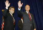 FILE - In this Nov. 26, 1991, file photo, President George H.W Bush, right, and William Barr wave after Barr was sworn in as the new Attorney General of the United States at a Justice Department ceremony in Washington. Barr, who served as attorney general under Bush, has emerged as a top contender for that job in President Donald Trump's Cabinet, two people familiar with the president's selection process said Thursday, Dec. 6, 2018. (AP Photo/Scott Applewhite, File)