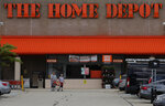 Shoppers leave the Home Depot store in Manchester, N.H., Thursday, Aug. 15, 2019.  The Home Depot Inc. (HD) on Tuesday, Aug. 20, reported fiscal second-quarter net income of $3.48 billion. On a per-share basis, the Atlanta-based company said it had net income of $3.17.  (AP Photo/Charles Krupa)