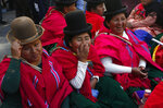 Aymara women, supporters of Bolivia's President Evo Morales, sit outside the presidential palace in La Paz, Bolivia, Thursday, Oct. 31, 2019. The women say they are keeping an eye out for anybody that might want to hurt President Morales. (AP Photo/Juan Karita)
