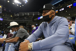 Chicago Bears quarterback Justin Fields watches during the second half of Game 3 of basketball's WNBA Finals between the Chicago Sky and Phoenix Mercury on Friday, Oct. 15, 2021, in Chicago. Chicago won 86-50. (AP Photo/Paul Beaty)