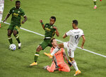 Real Salt Lake forward Justin Meram, right puts a shot on goal as Portland Timbers goalkeeper Steve Clark and forward Jeremy Ebobisse, center, defend and Timbers defender Larrys Mabiala looks at the ball at his feet during the first half of an MLS soccer match in Portland, Ore., Saturday, Aug. 29, 2020. (AP Photo/Steve Dykes)