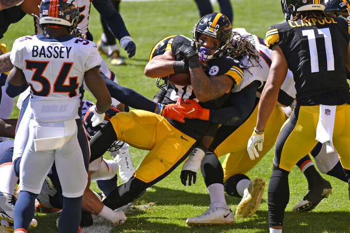 Pittsburgh Steelers running back James Conner (30) scores on a 3-yard run during the first half of an NFL football game against the Denver Broncos in Pittsburgh, Sunday, Sept. 20, 2020. (AP Photo/Don Wright)