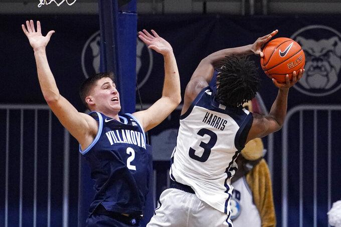 Butler guard Chuck Harris (3) shoots over Villanova guard Collin Gillespie (2) in the first half of an NCAA college basketball game in Indianapolis, Sunday, Feb. 28, 2021. (AP Photo/Michael Conroy)