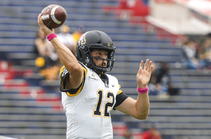 Appalachian State quarterback Zac Thomas (12) fires a pass down field against South Alabama during the first half of an NCAA college football game Saturday, Oct. 26, 2019, at Ladd-Peebles Stadium in Mobile, Ala. (AP Photo/Julie Bennett)