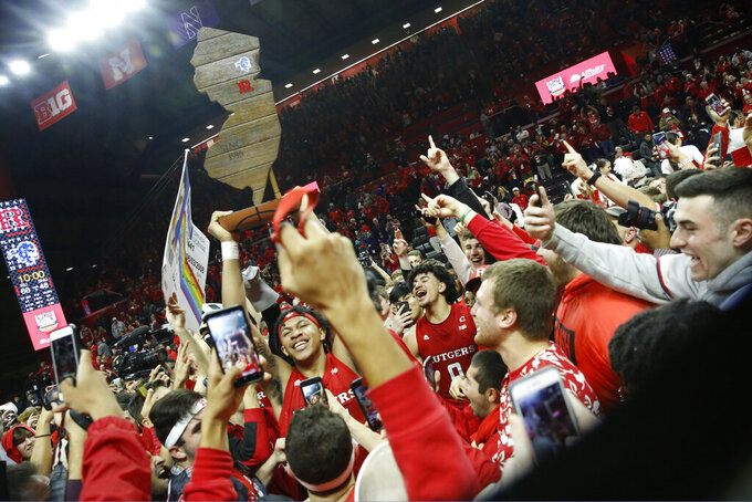Rutgers guard Ron Harper Jr. (24) holds the Garden State Hardwood Classic trophy after Rutgers defeated Seton Hall 68-48 in an NCAA college basketball game, Saturday, Dec. 14, 2019, in Piscataway, N.J. (AP Photo/Kathy Willens)