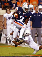 Virginia wide receiver Joe Reed (2) is tackled by Old Dominion linebacker Ryan Henry (8) during the first quarter of an NCAA college football game in Charlottesville, Va., Saturday, Sept. 21, 2019. (AP Photo/Andrew Shurtleff)