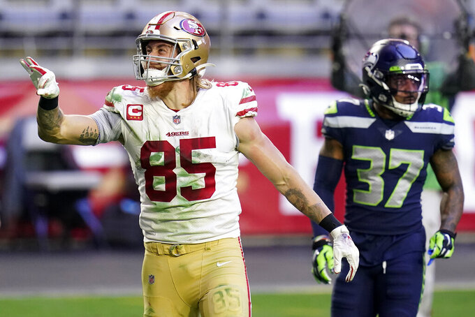 San Francisco 49ers tight end George Kittle (85) signals first down as Seattle Seahawks free safety Quandre Diggs (37) looks on during the second half of an NFL football game, Sunday, Jan. 3, 2021, in Glendale, Ariz. (AP Photo/Ross D. Franklin)