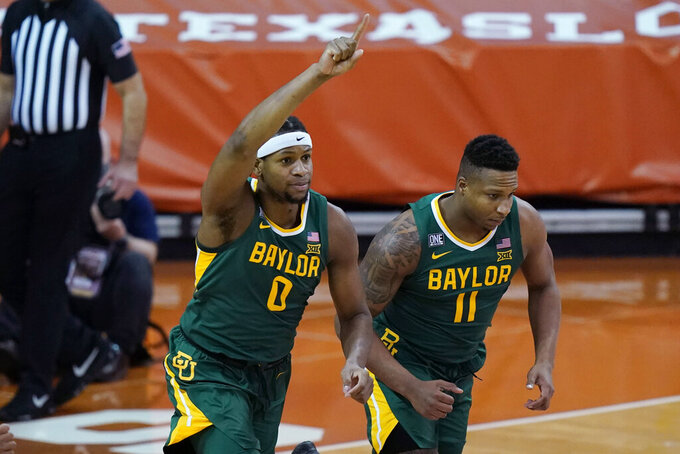 Baylor forward Flo Thamba (0) celebrates a score against Texas during the first half of an NCAA college basketball game Tuesday, Feb. 2, 2021, in Austin, Texas. (AP Photo/Eric Gay)
