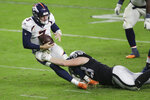 Las Vegas Raiders defensive end Maxx Crosby (98) sacks Denver Broncos quarterback Drew Lock (3) during the second half of an NFL football game, Sunday, Nov. 15, 2020, in Las Vegas. (AP Photo/Isaac Brekken)