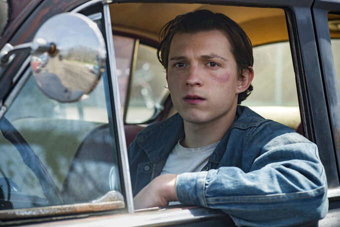 """This image released by Netflix shows Tom Holland in a scene from """"The Devil All The Time."""" Antonio Campos' Appalachian noir film premieres Wednesday on Netflix. (Glen Wilson/Netflix via AP)"""