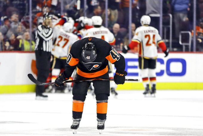 Philadelphia Flyers' Jordan Weal skates off the ice after the Flyers lost  3-2 in overtime against the Calgary Flames in an NHL hockey game, Saturday, Jan. 5, 2019, in Philadelphia. (AP Photo/Matt Slocum)