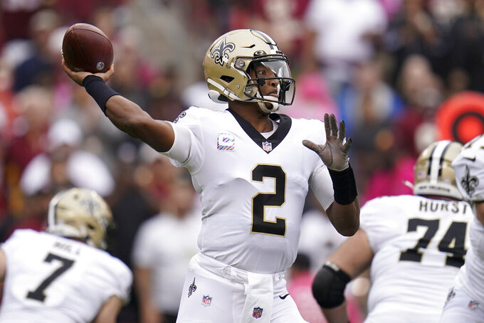 New Orleans Saints quarterback Jameis Winston throws a pass in the first half of an NFL football game against the Washington Football Team, Sunday, Oct. 10, 2021, in Landover, Md. (AP Photo/Julio Cortez)
