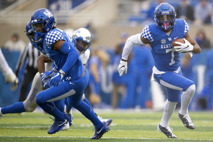 Kentucky safety Mike Edwards (7) runs with the ball during the first half of an NCAA college football game against Middle Tennessee in Lexington, Ky., Saturday, Nov. 17, 2018. (AP Photo/Bryan Woolston)