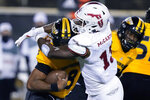 Florida Atlantic linebacker Leighton McCarthy (13) sacks Southern Mississippi quarterback Trey Lowe (8) during the second half of an NCAA college football game Thursday, Dec. 10, 2020, in Hattiesburg, Miss. (AP Photo/Rogelio V. Solis)